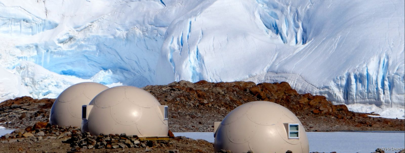 Sleeping pods in front of the ice fall