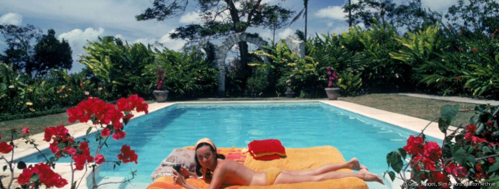 The former Pauline Haywood sunbathing on a lilo in a swimming pool designed by English artist Oliver Messel, Barbados, April 1976. Her family owned Haywood's Plantation.
